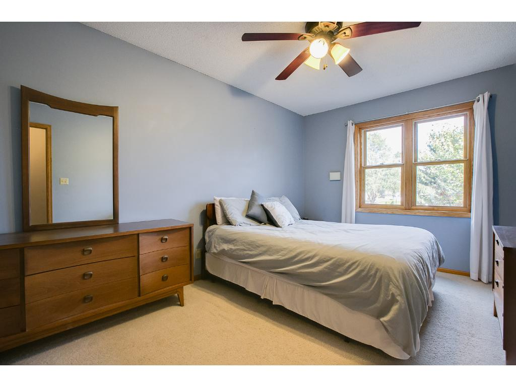 Nice sized master bedroom with a ceiling fan