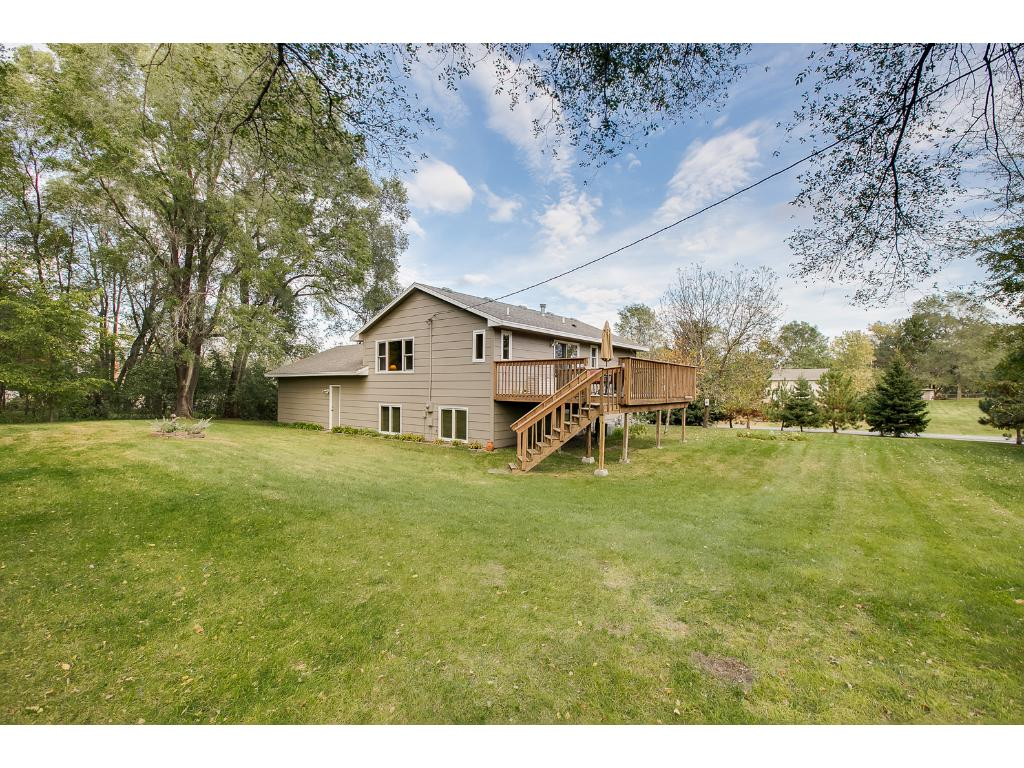 This is an AMAZING location and lot! 1.033 acres, beautiful deck, great trees and close to everything you need