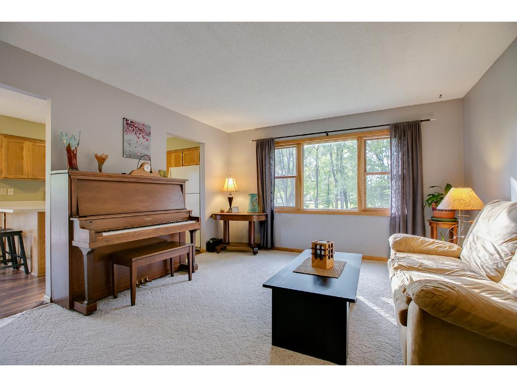 The upper level features an open floor plan, new windows and a great living room