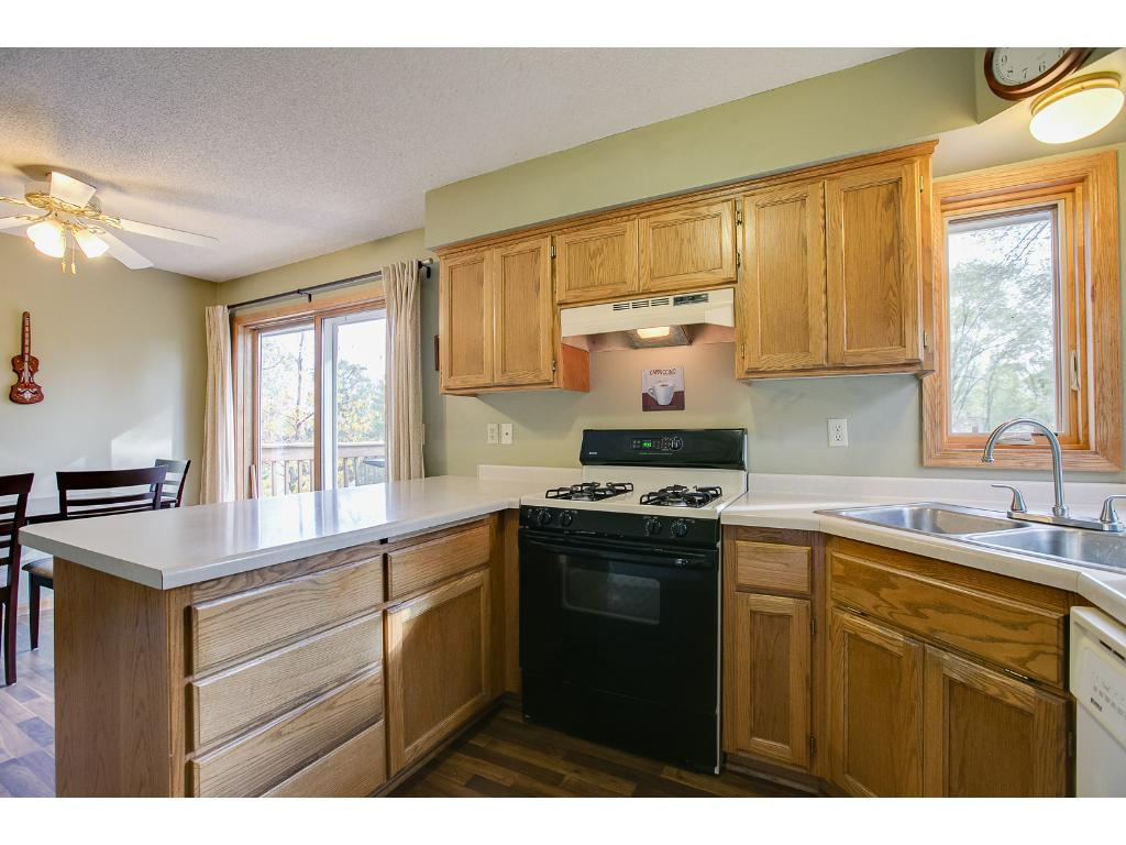 The kitchen has a breakfast area as well as a nice sized dining room with all new flooring and walks out to a gorgeous deck