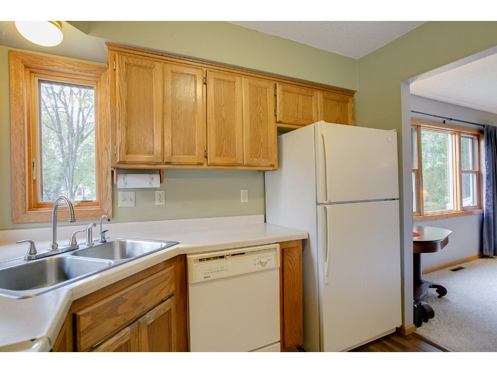 Kitchen showing the walk thru to the living room and newly replaced windows