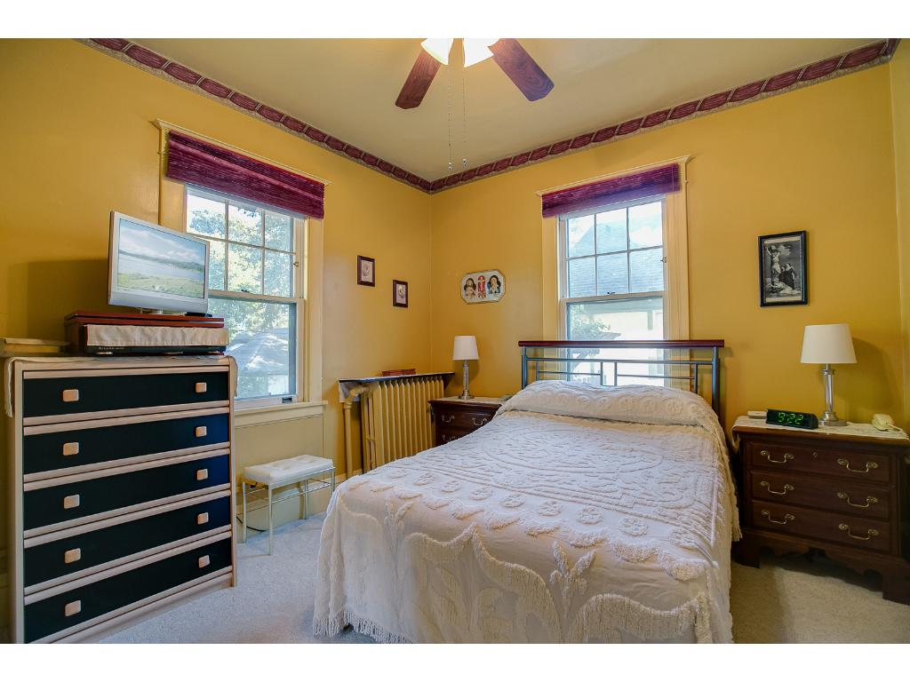 Wonderful main floor bedroom features a walk-in closet and a ceiling fan!