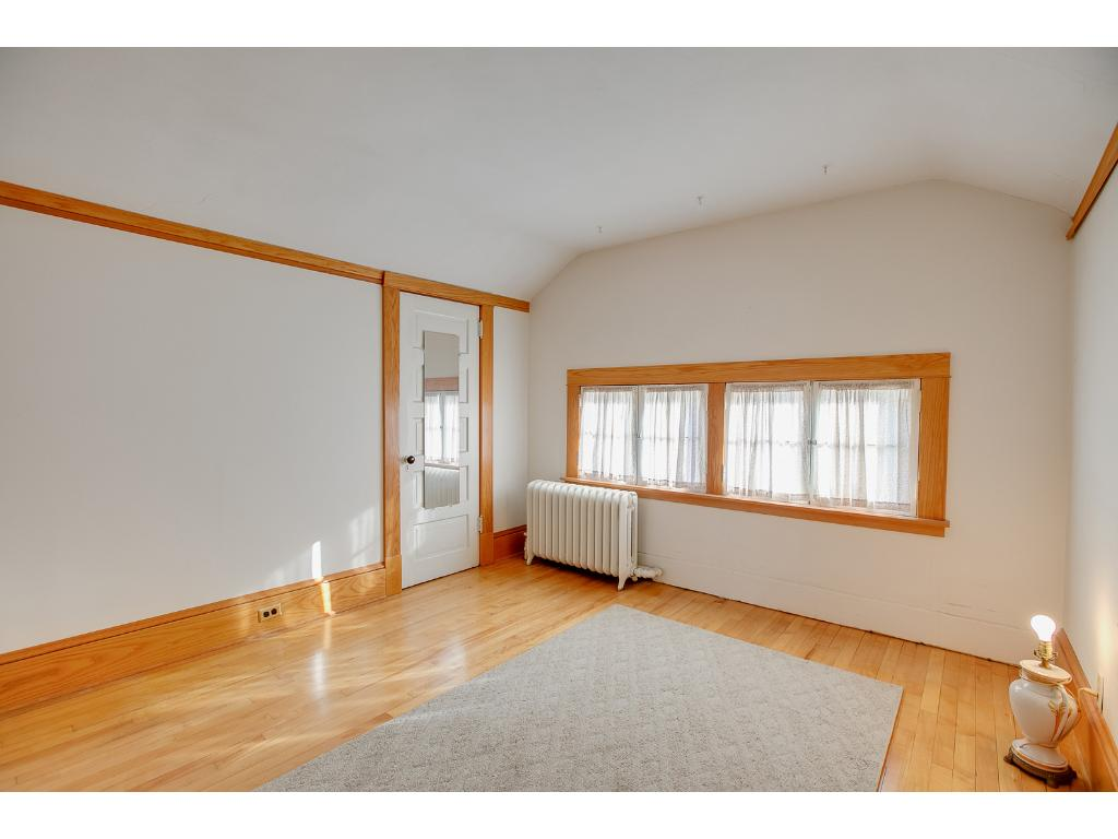 Spacious upper level bedroom features a walk-in closet and beautiful hardwood floors!