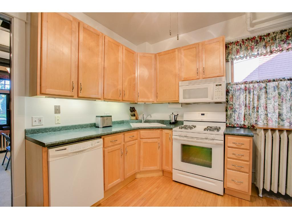 Charming main floor kitchen features ample cabinet storage space!