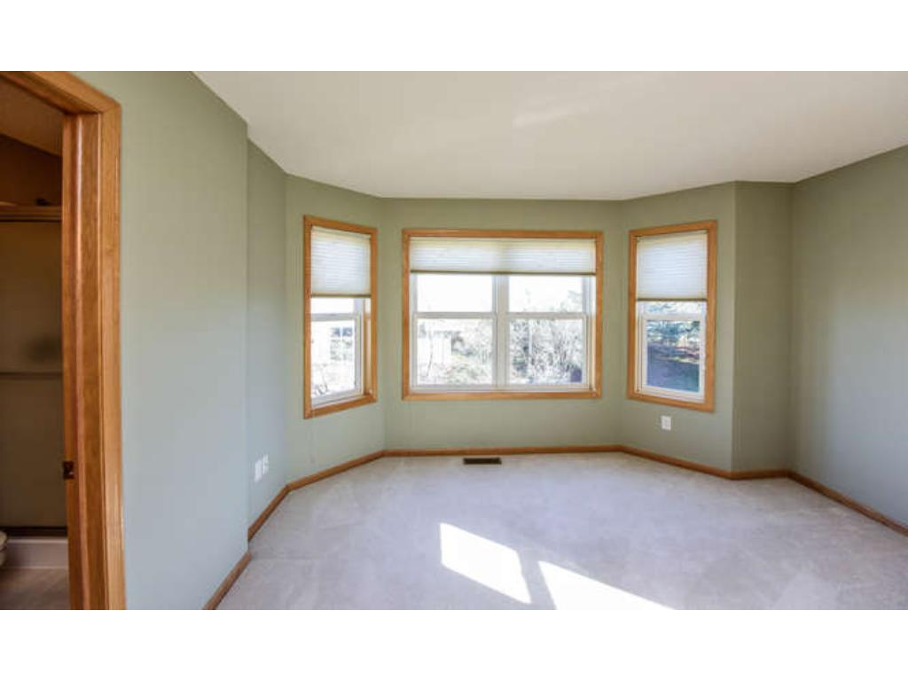 Master bedroom with bay window, spacious closet, and private bathroom.