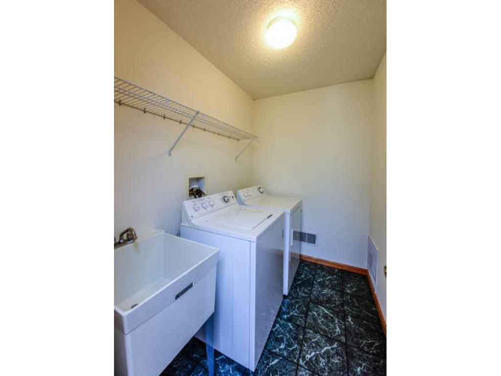 Upstairs laundry room with sink.