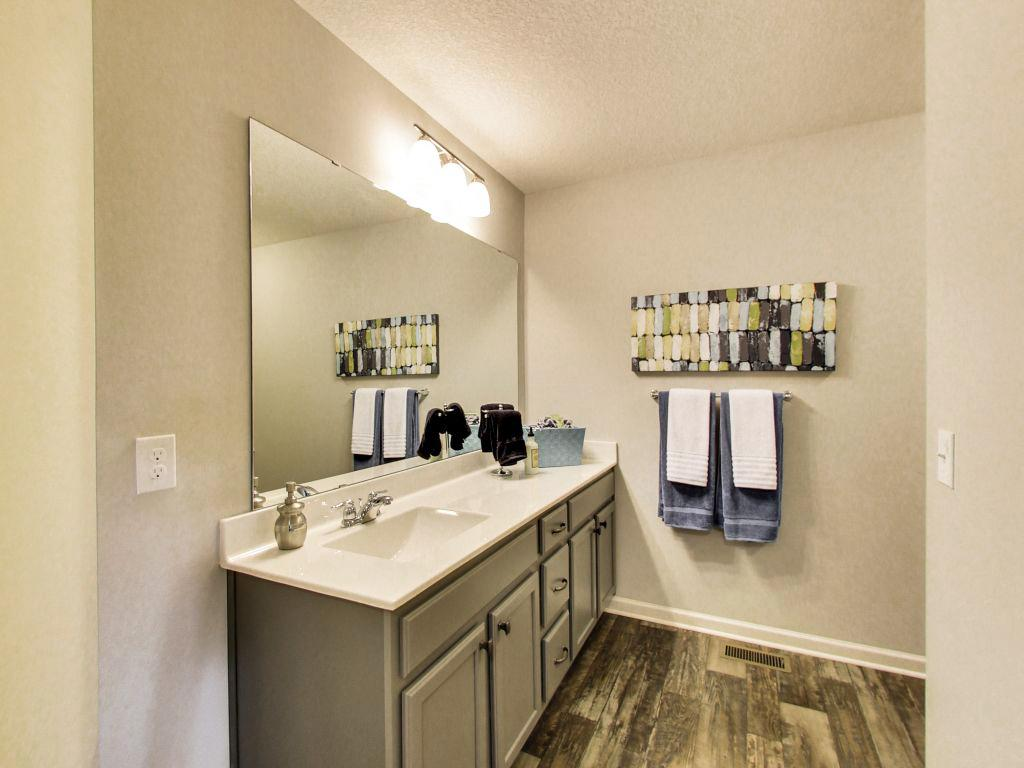 Your main bath has a long vanity and separate linen cabinet. Photo ...