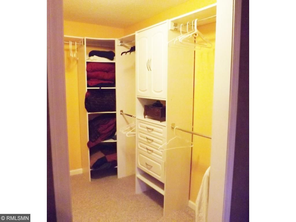 Lots of room in custom wardrobe closet!  No need for a dresser in bedroom with all of these sweet storage spots!