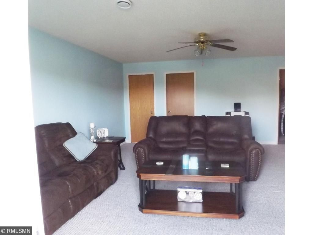 Lower level family room.  Newly updated with white trim and calming colors.  Relax with room for the whole family.