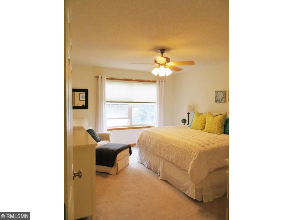 Large master bedroom with ceiling fan and two closets!