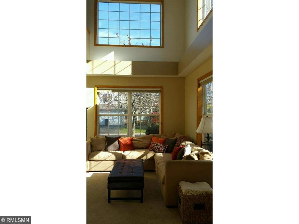 So much natural light spills into this space with the two-story family room and extra large windows!