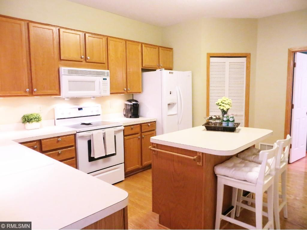 The center island offers additional counter space and seating, great for entertaining friends and family!