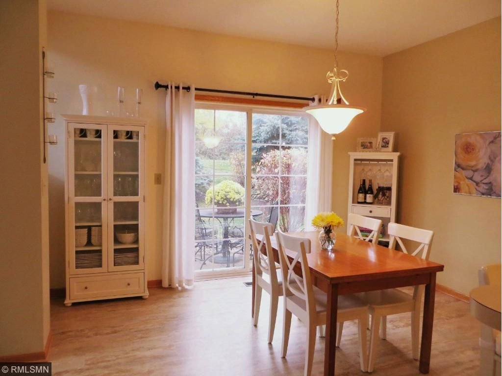 The dining room is so bright and walks out to your private patio.  Enjoy summer grilling and the outdoor seating!