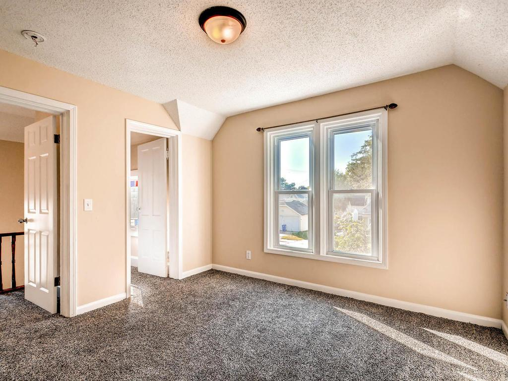 Three spacious bedrooms on the upper level.