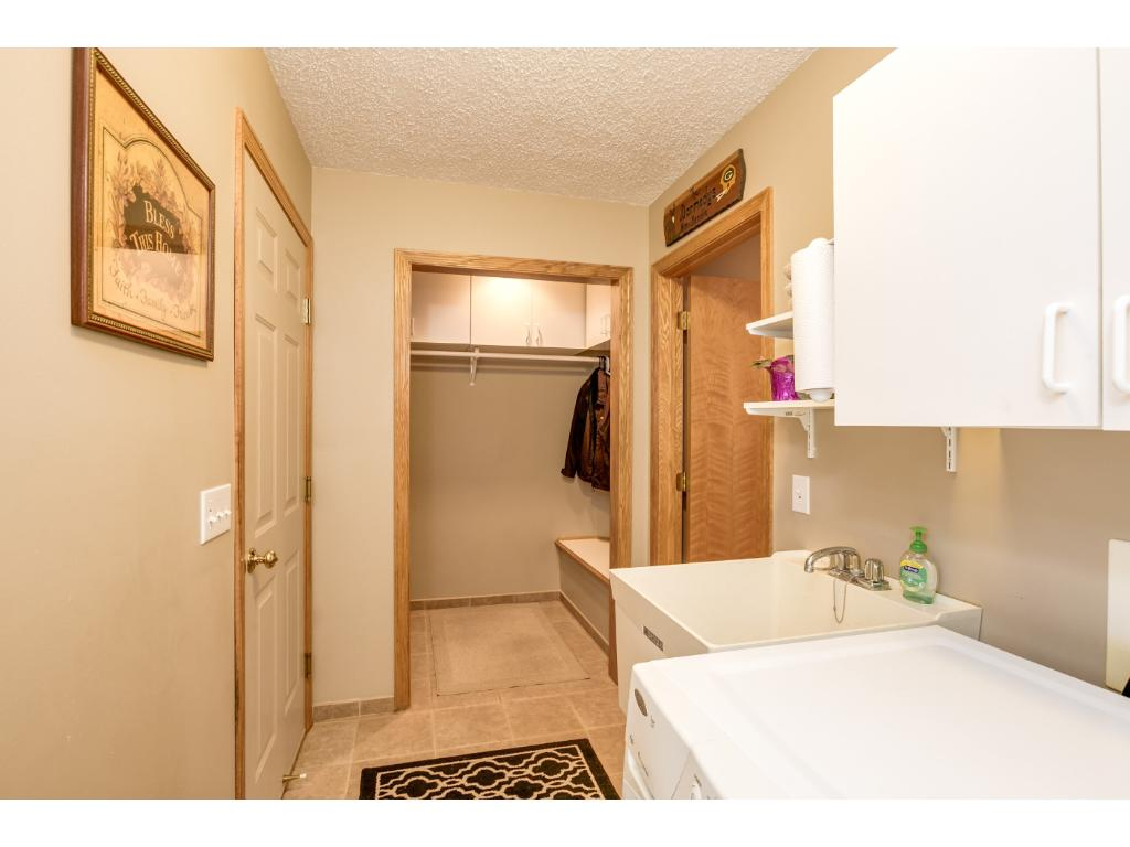 Main level laundry with great storage coat closet