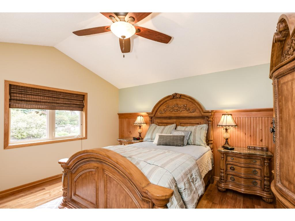 Great master bedroom with vaulted ceiling and ceiling fan.  Features a large walk in closet.