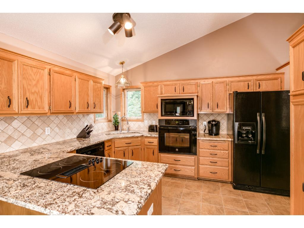 Granite counters, black appliances give a very contemorary look