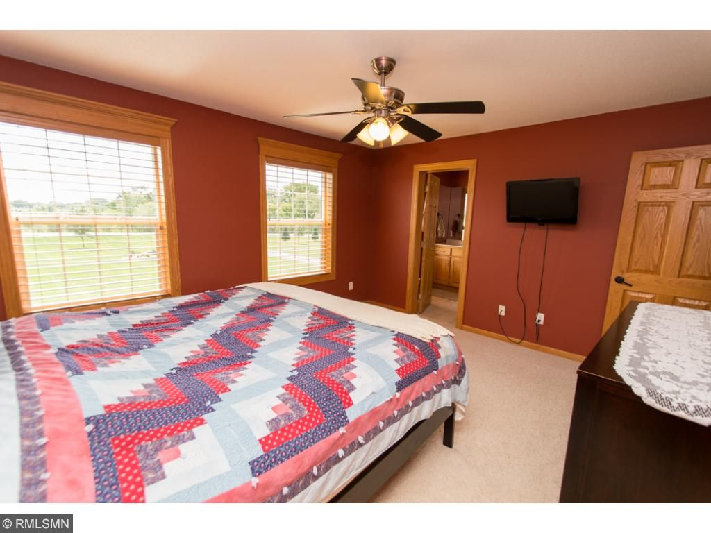 Master bedroom has large windows & plenty of space.