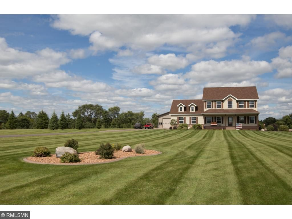 Immaculate lawn on 2.69 acres with sprinkler system and professional landscaping.