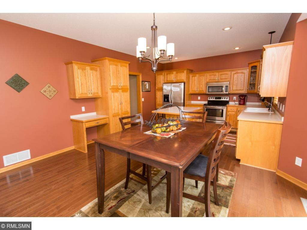 Dining room & kitchen have beautiful hard wood floors, stainless steel appliances, large island & built in desk.