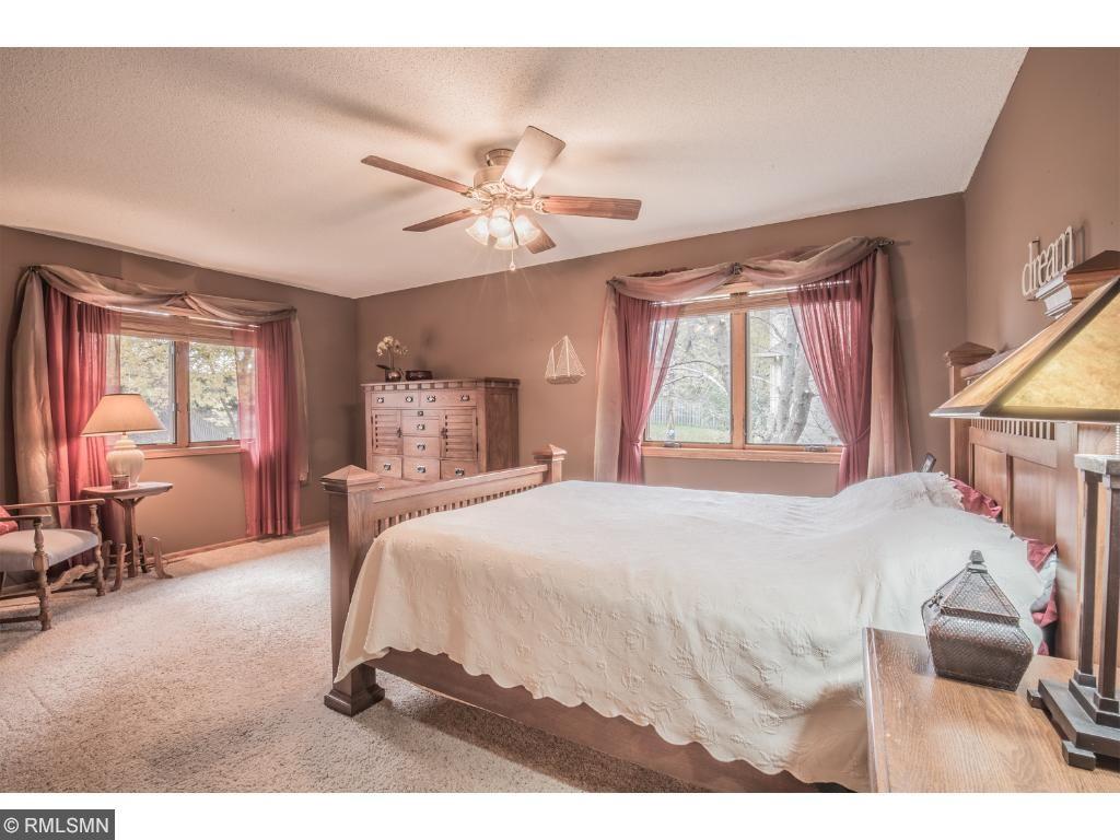 Grand master bedroom with serene backyard views.