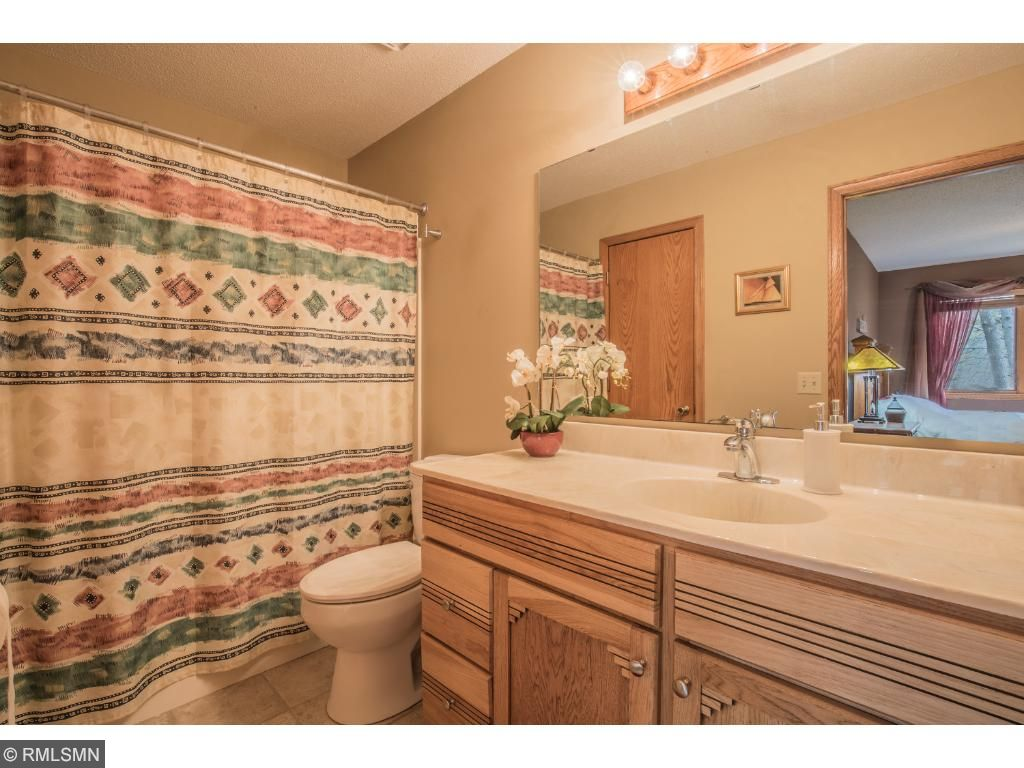Private master full bath with tile floor and linen closet.