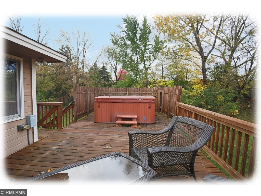 Enjoy hours of relaxation on the private main level deck, or in the hot tub, with steps to the expansive fully fenced backyard making outdoor cooking, recreation, and entertaining a joy.