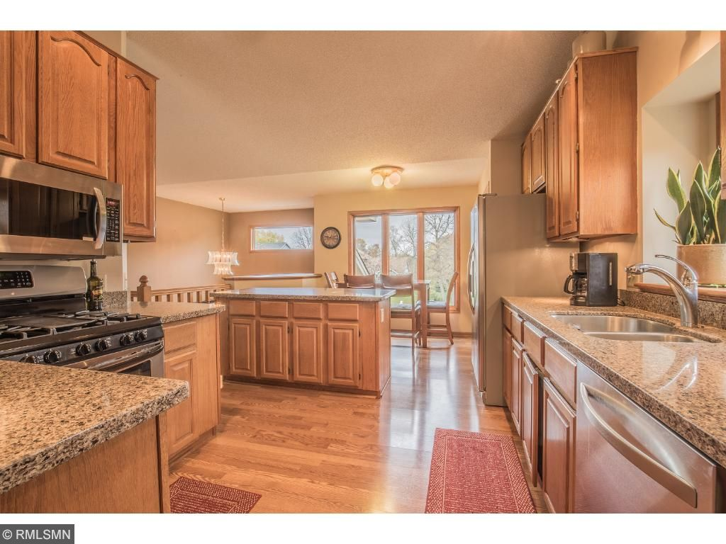Adjacent dinette area with closet pantry and front yard views.