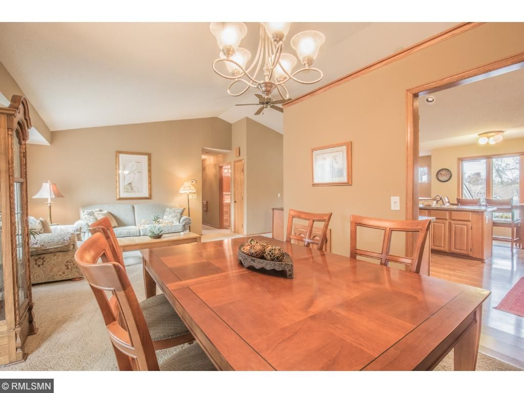 Dining room offers vaulted ceiling.