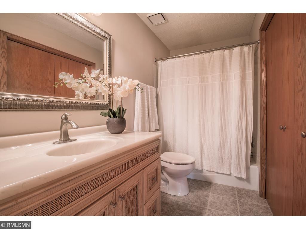 Full bath with tile floor and bath/shower area.