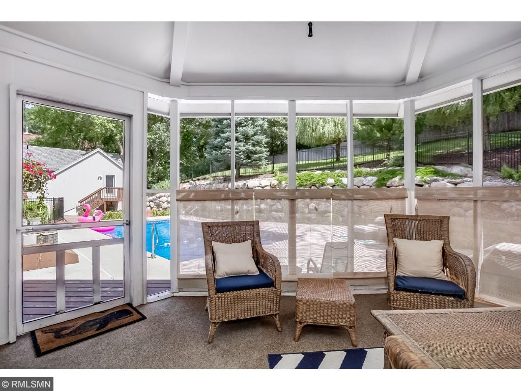 Screen Porch with Easy Access to Pool, Grill and Hot Tub.