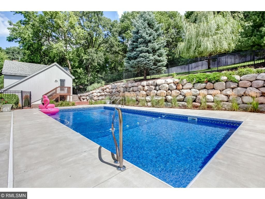 Beautifully landscaped pool and surrounding area.