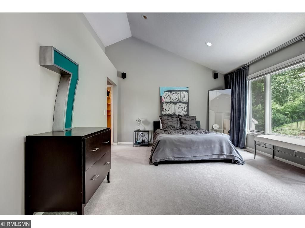 Owner's Suite with Vaulted Ceiling, Dual Oversized Walk-in Closets with Private Laundry.