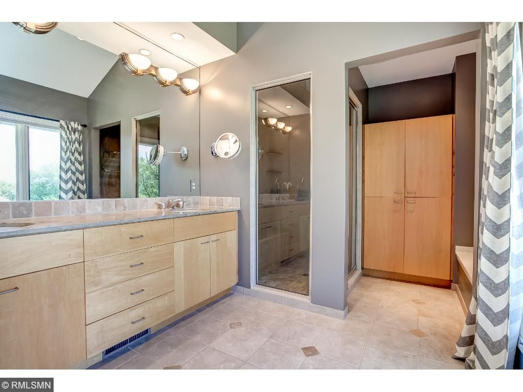 Serenity bath with steam shower, heated floors and dual bowl vanity.