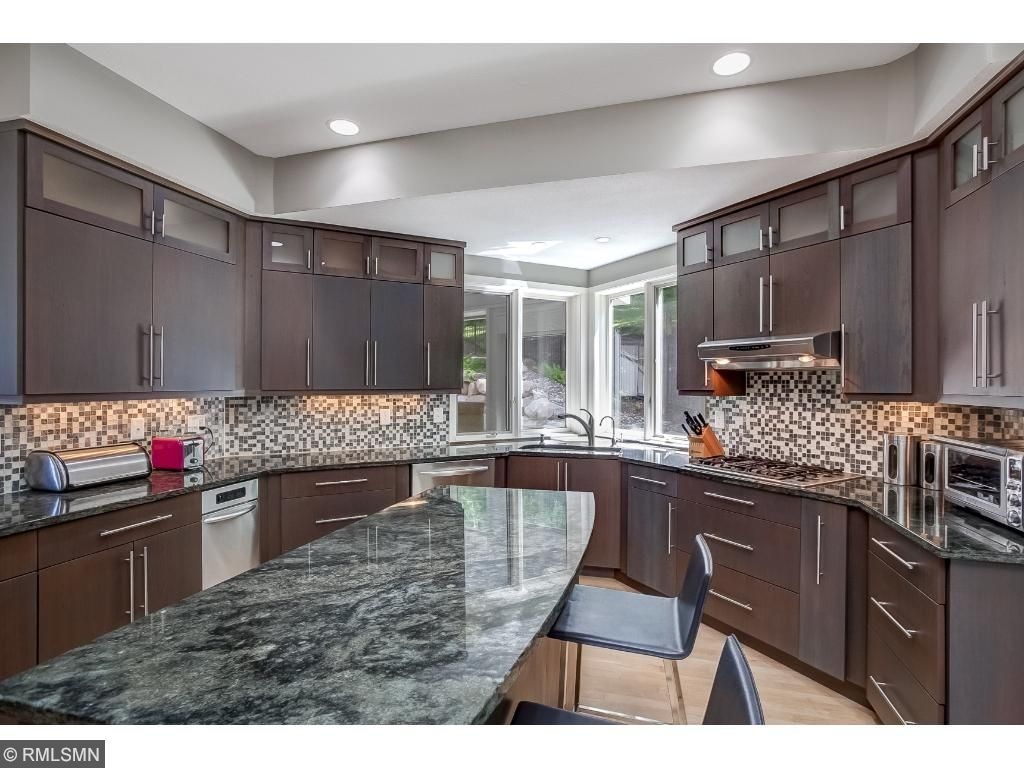 Gourmet Kitchen Featuring Granite Counter tops, Tile Back Splash, Stainless Steel Appliances.
