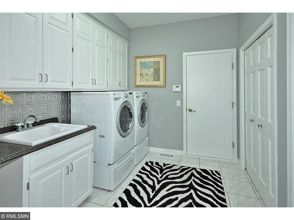 Main floor laundry room that opens to the large 3 car garage