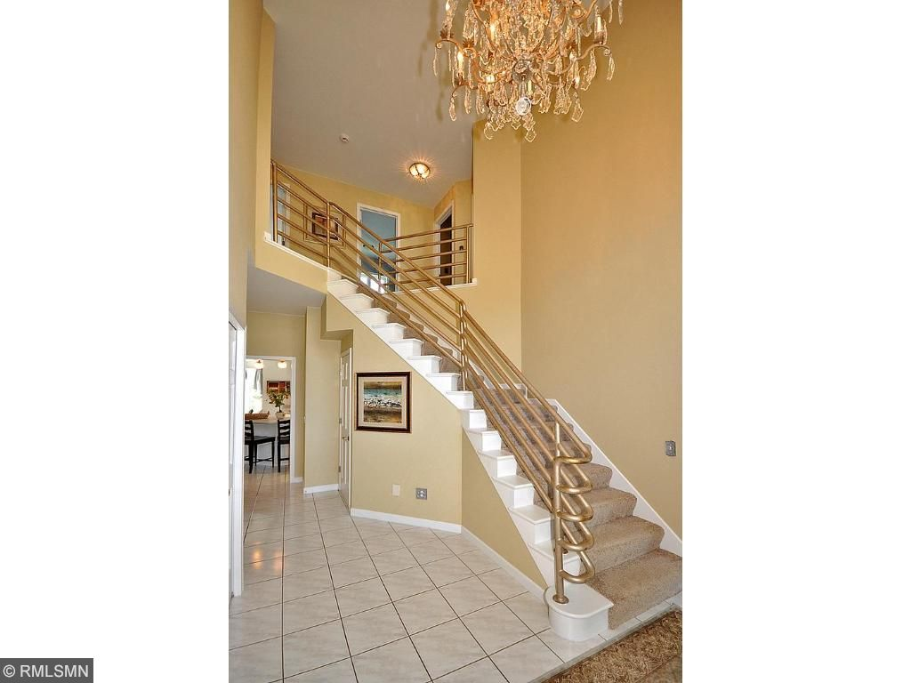 Enter into the stunning, high ceiling foyer with a beautiful crystal chanelier