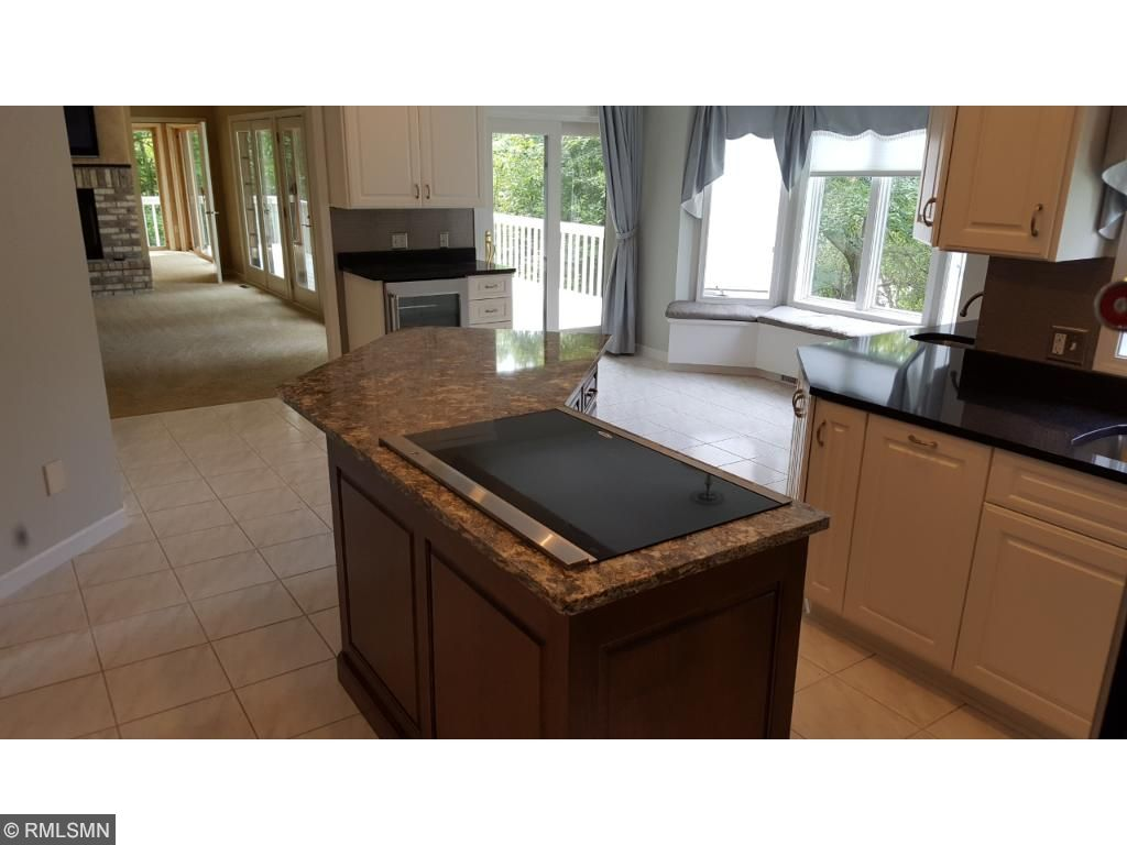 Center island with brand new cooktop and Cambria countertops