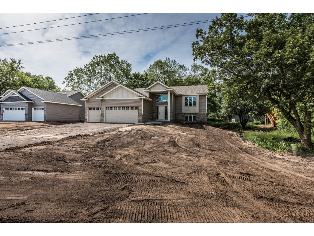 Fantastic Curb Appeal; wooded lot and Oversized 3 Car Garage! Includes Black Dirt & Sod!!