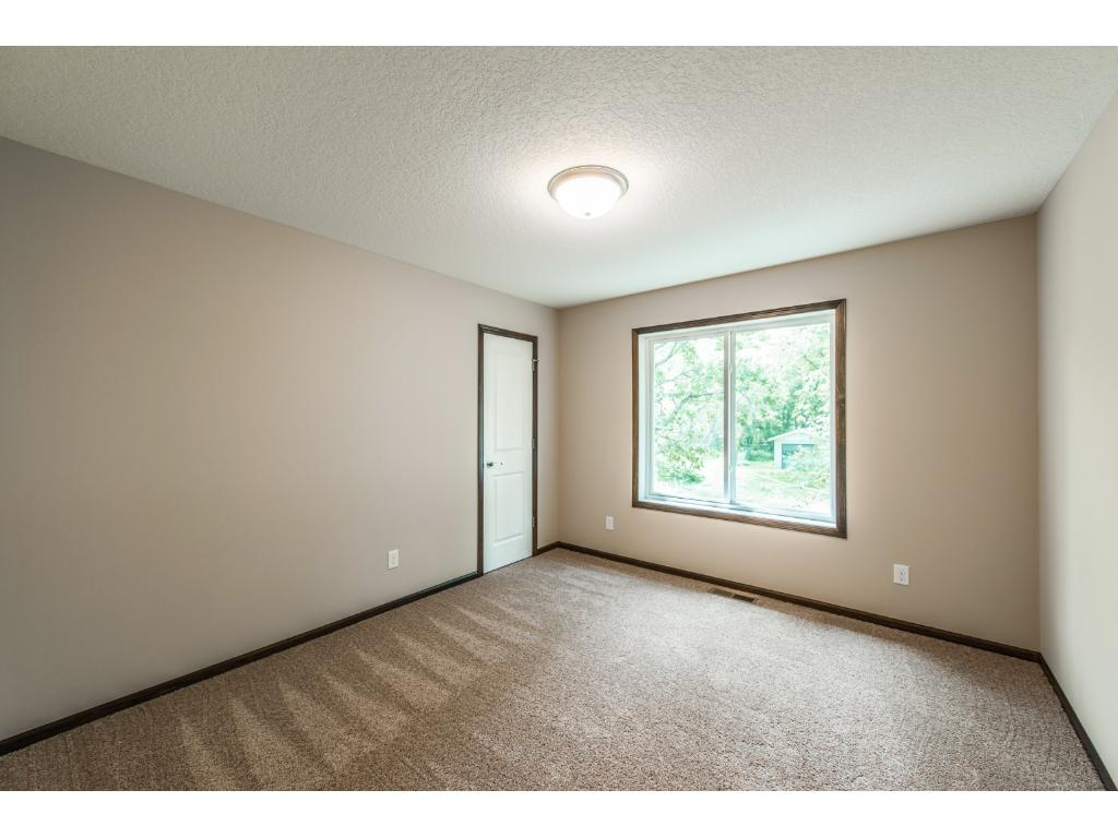 The Second Bedroom on the Main Level is a great size and also has a Walk In Closet.