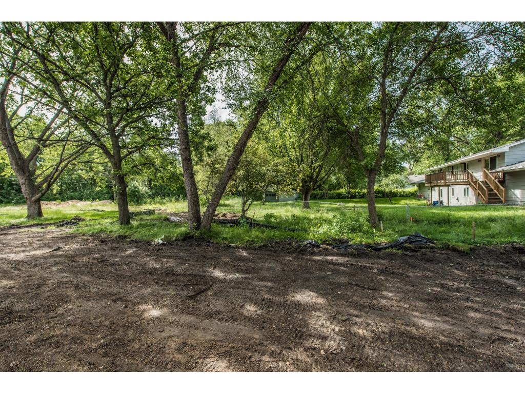 The Wooded Backyard has beautiful nature views and is great for Outdoor Activities. Includes Black Dirt & Sod!