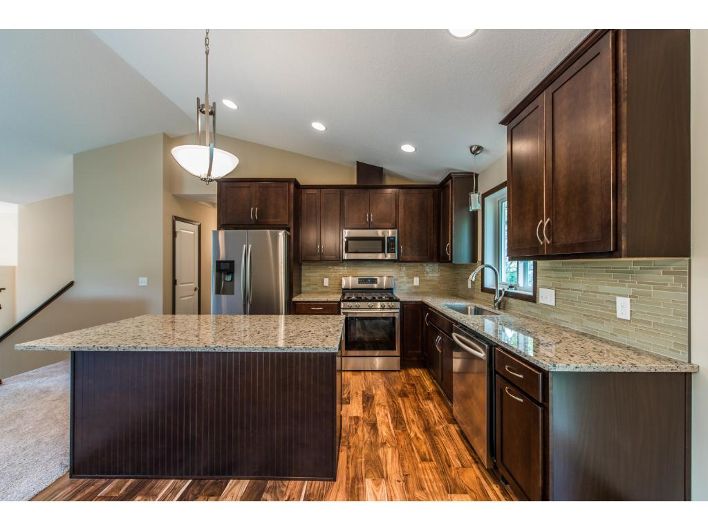 "The Kitchen Features 42"" Cabinets with Dovetail Soft Close Drawers & Doors! Major upgraded Appliances, Hardwood Floors, a Large Center Island with Beautiful Granite and a Mosaic Glass Backsplash."