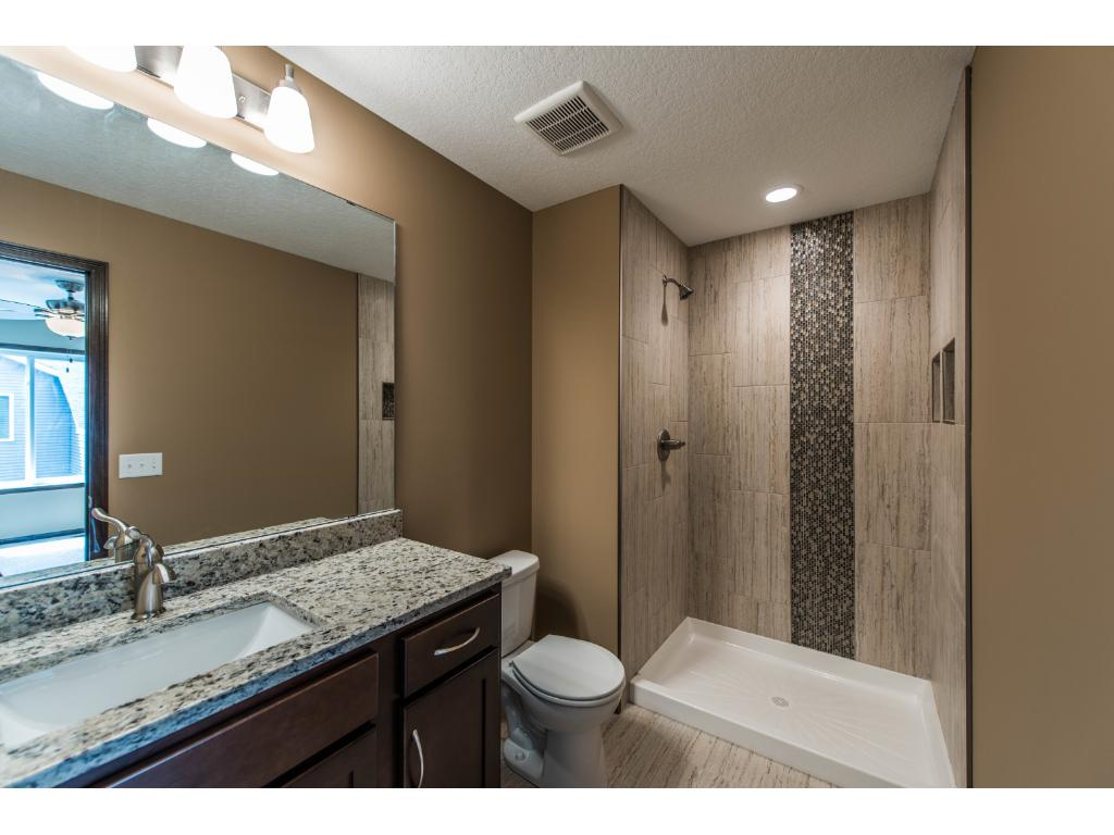 Here's the Luxury Master Bath with Granite Countertop, Square Sink, Upgraded Faucets & Custom High End Tile Throughout!