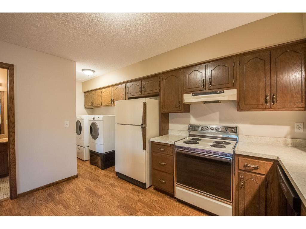 Kitchen has laundry closet with newer washer and dryer.