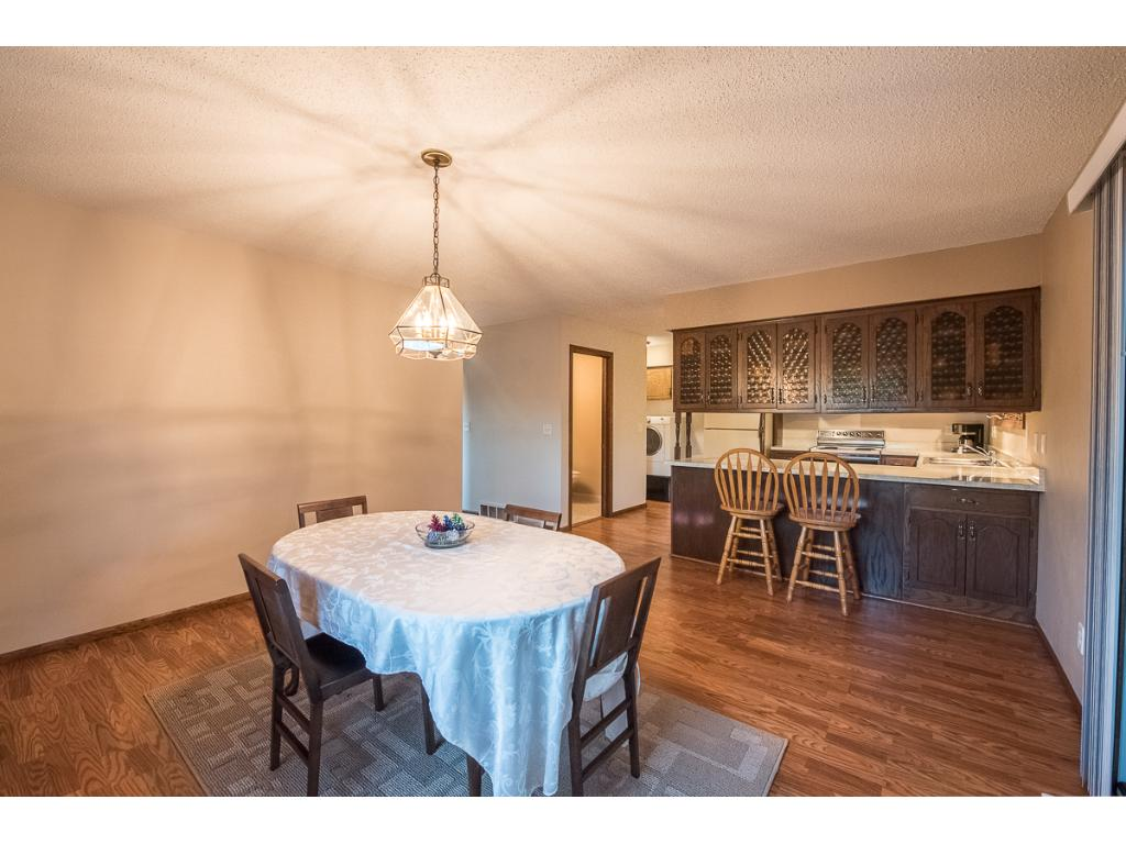 Kitchen opens up to big dining rooms.