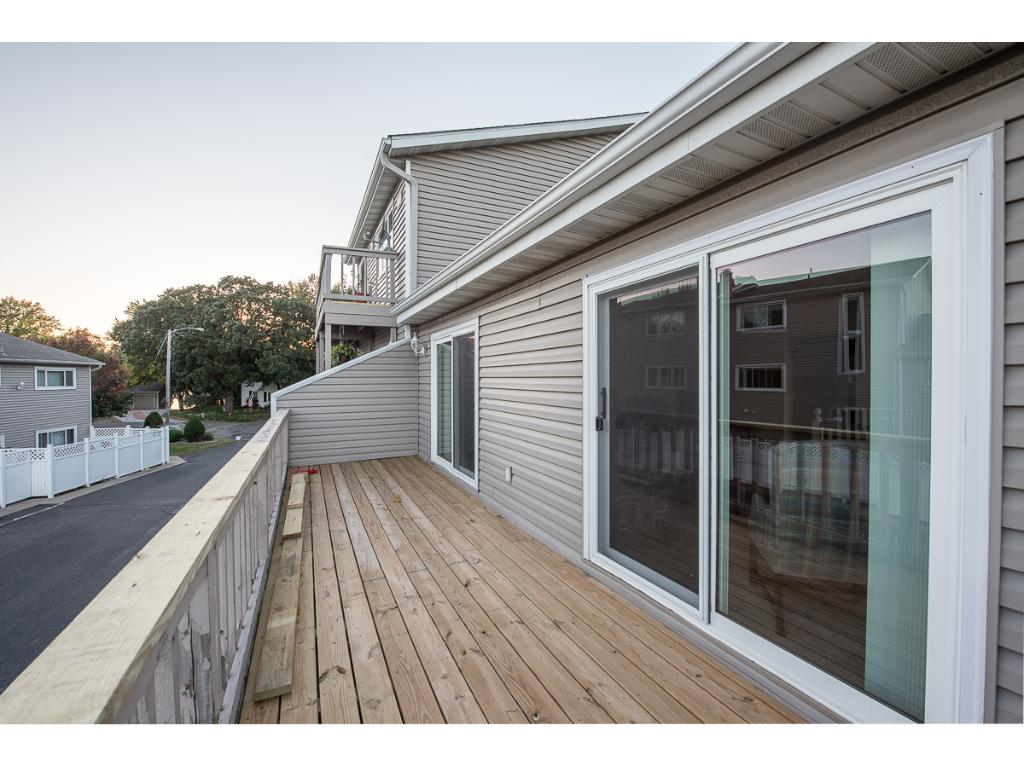 Lots of entertaining space in this home; 2 decks, private patio and river access!