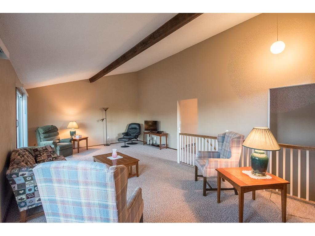 Large living room with vaulted ceilings.