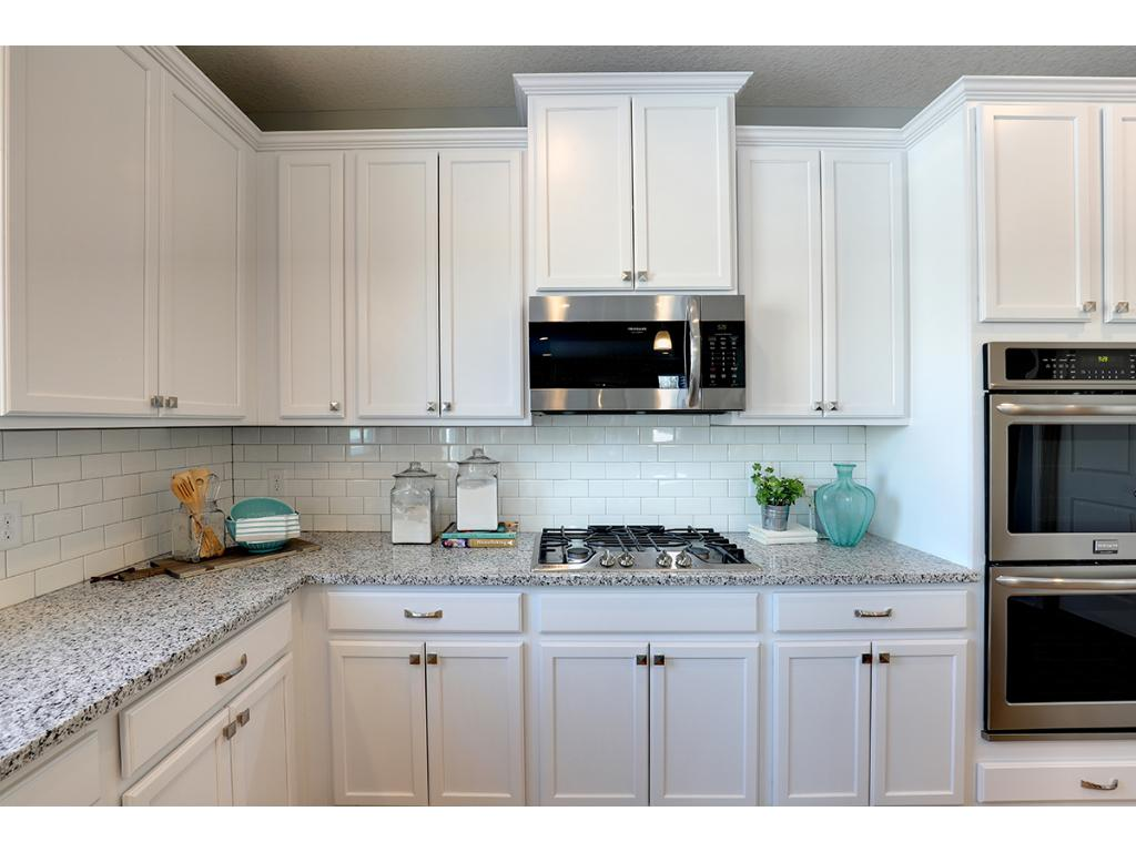 42u0027 Cabinets With Stately Crown Molding, Natural Stone Countertops, Walk In  Pantry