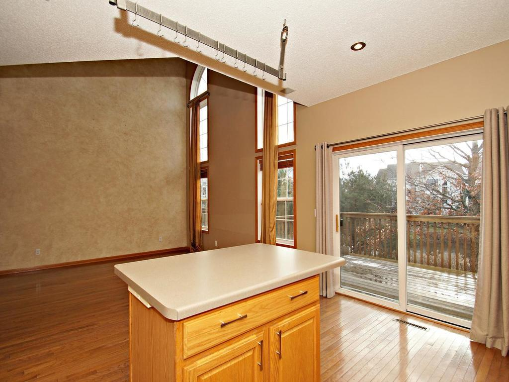 Kitchen over looks the open concept dining space and is just steps to the deck making grilling a effortless affair.