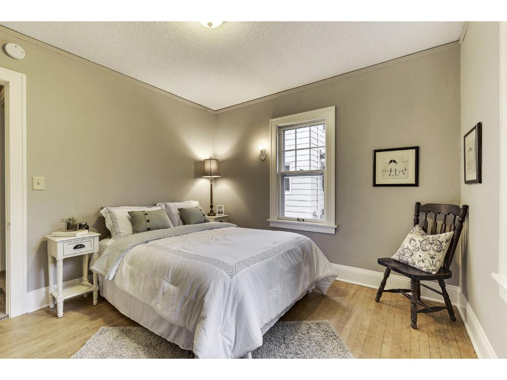 One of the two main floor bedrooms with HWD floors.